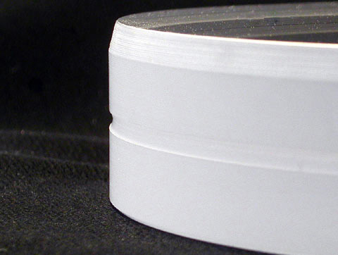 The edge of an optical flat with a groove and bevel.