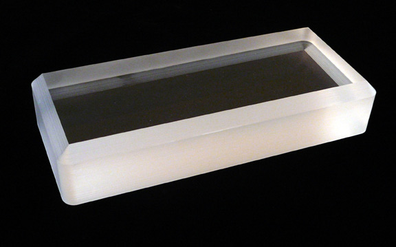 Rectangular fused silica window with a beveled edge.