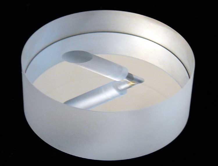 Aluminum-coated mirror with thru-hole that has counter-bore.